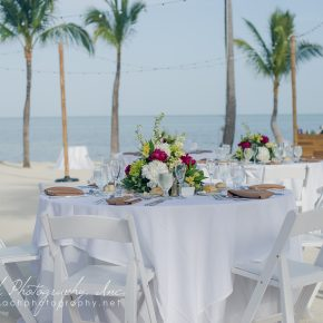 Tables and chairs for a beach wedding reception set up