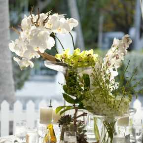 Wedding Banquet Table With Flowers & Dishes