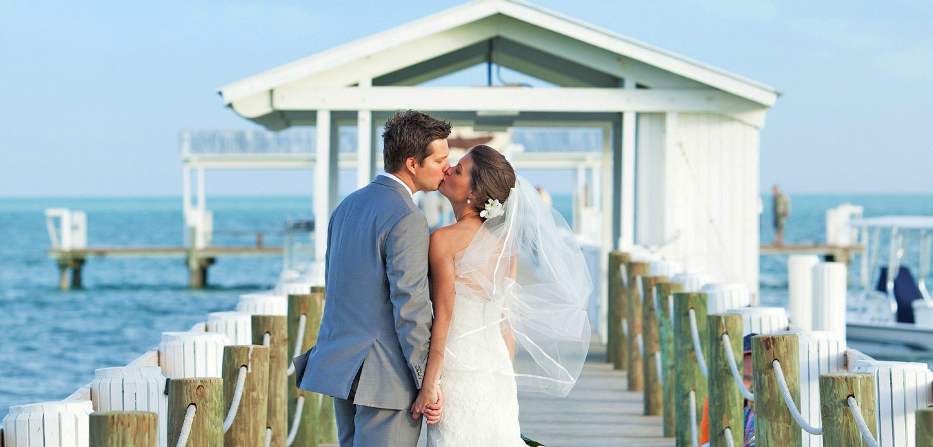 Newly Married Couple Kiss on the Pier