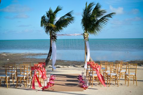 Wedding ceremony archway at beach.