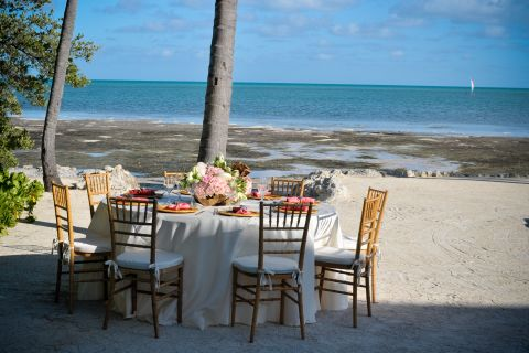 Beach wedding reception table and chairs