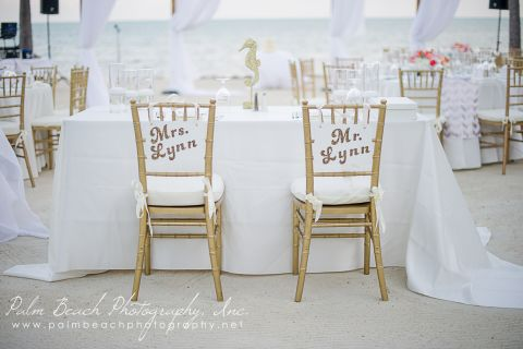 Close up of married couples chair at wedding reception.