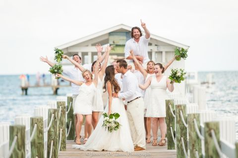 Wedding party posing for a photo on the pier